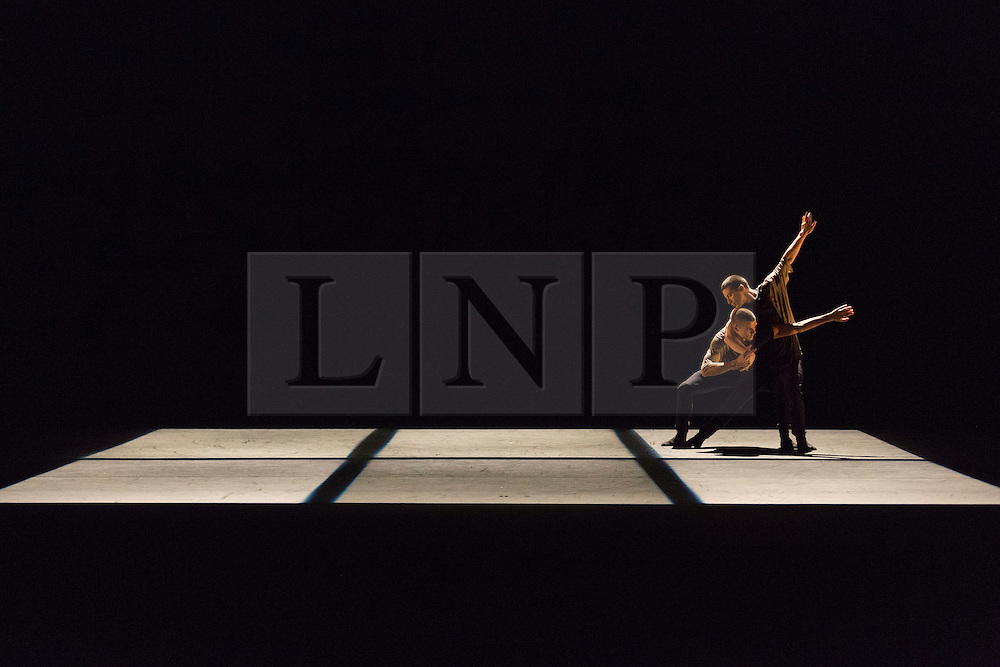 © Licensed to London News Pictures. 24/11/2015. London, UK. Adam Kirkham and Nathan Young performing Piece No. 43. Russell Maliphant Company present Conceal / Reveal at Sadler's Wells from 26 to 28 November 2015. Conceal / Reveal is the 20th anniversary celebration between dance choreographer Russell Maliphant and lighting designer Michael Hulls. Photo credit: Bettina Strenske/LNP