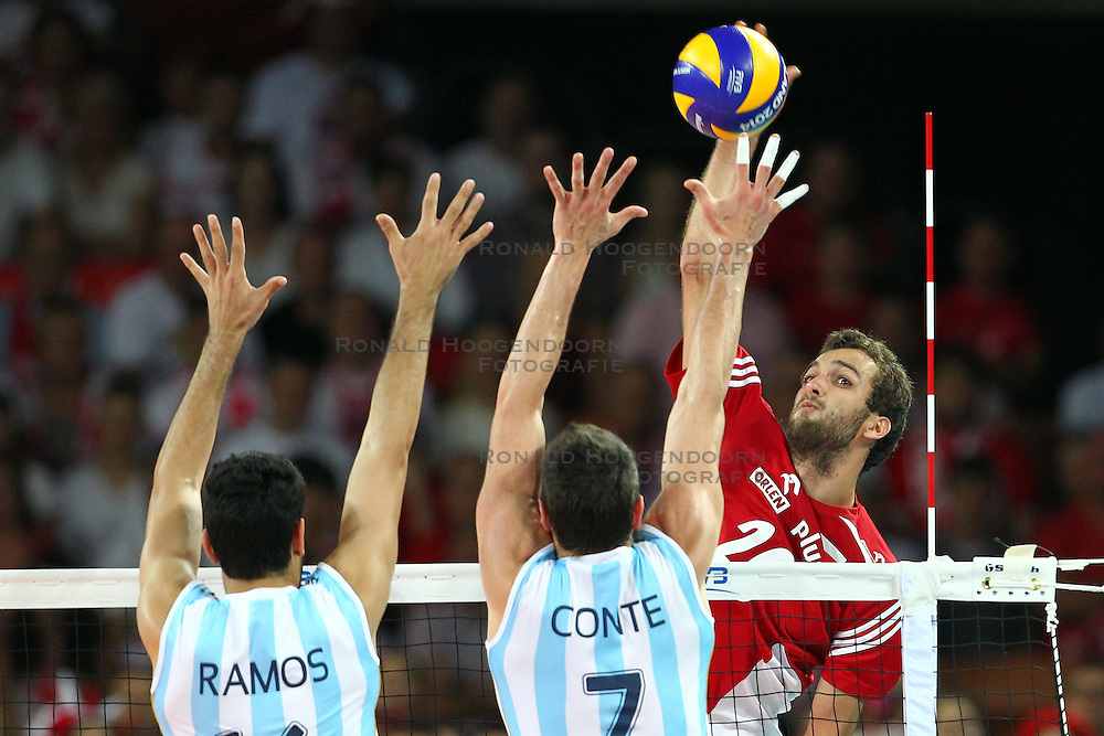 07.09.2014, Centennial Hall, Breslau, POL, FIVB WM, Polen vs Argentinien, Gruppe A, im Bild (P) MATEUSZ MIKA // during the FIVB Volleyball Men's World Championships Pool A Match beween Poland and Argentina at the Centennial Hall in Breslau, Poland on 2014/09/07.<br /> <br /> ***NETHERLANDS ONLY***