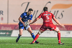 Leinster's Ross Byrne evades the tackle of Scarlets' David Bulbring<br /> <br /> Photographer Craig Thomas/Replay Images<br /> <br /> Guinness PRO14 Round 17 - Scarlets v Leinster - Friday 9th March 2018 - Parc Y Scarlets - Llanelli<br /> <br /> World Copyright © Replay Images . All rights reserved. info@replayimages.co.uk - http://replayimages.co.uk
