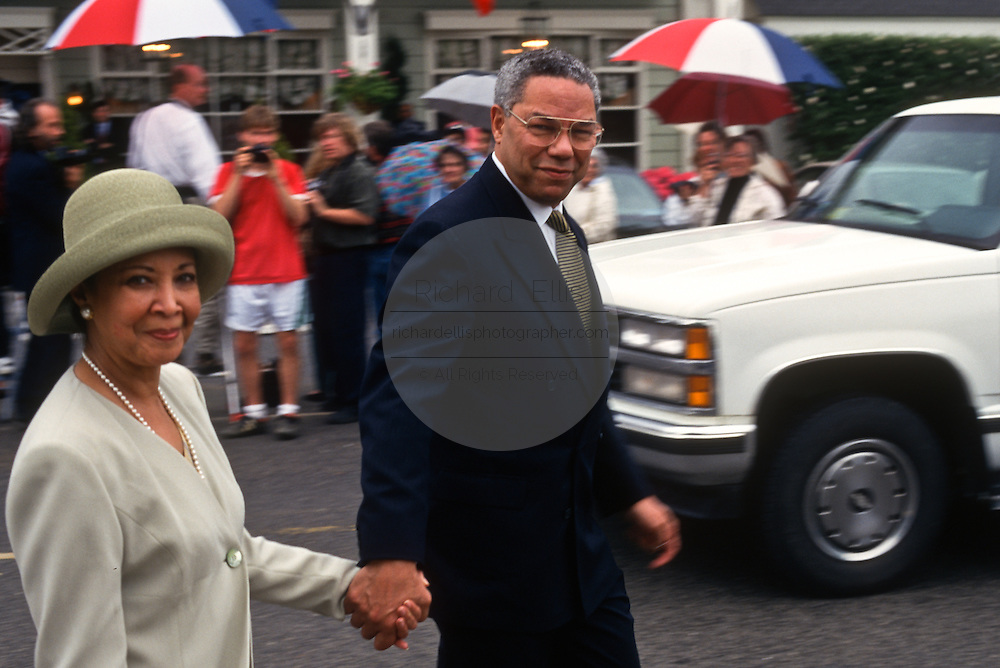 General Colin Powell with wife Alma following the wedding of Federal Reserve Board Chairman Alan Greenspan and NBC Television correspondent Andrea Mitchell outside the The Inn in Little Washington, Va. April 6,1997.