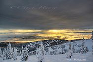 Sunset lights up inversion clouds from the Whitefish Mountain Resort in Montana