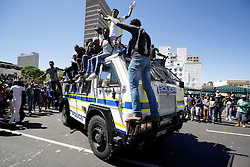 Wednesday 26 October 2016.<br /> Parliament, Cape Town,<br /> Western Cape,<br /> South Africa<br /> <br /> Fees Must Fall Protest March In Cape Town.<br /> <br /> Students ride on top of a Police Nyala armoured vehicle while protesting outside Parliament in Cape Town.<br /> <br /> Students and supporters march to parliament in protest against higher education fees in South Africa on the 26th October 2016. The students are protesting against the fees for higher education. This protest is part of the #FeesMustFall campaign.<br /> <br /> Picture By: Mark Wessels/ RealTime Images.