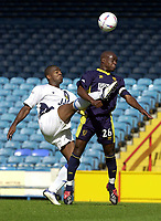Photo: Greig Cowie.<br /> 13/09/2003.<br /> Nationwide League Division 1. Wimbledon v Wigan Athletic, Selhurst Park.<br /> Nathan Ellington gets a high boot in on Nigel Reo-Coker