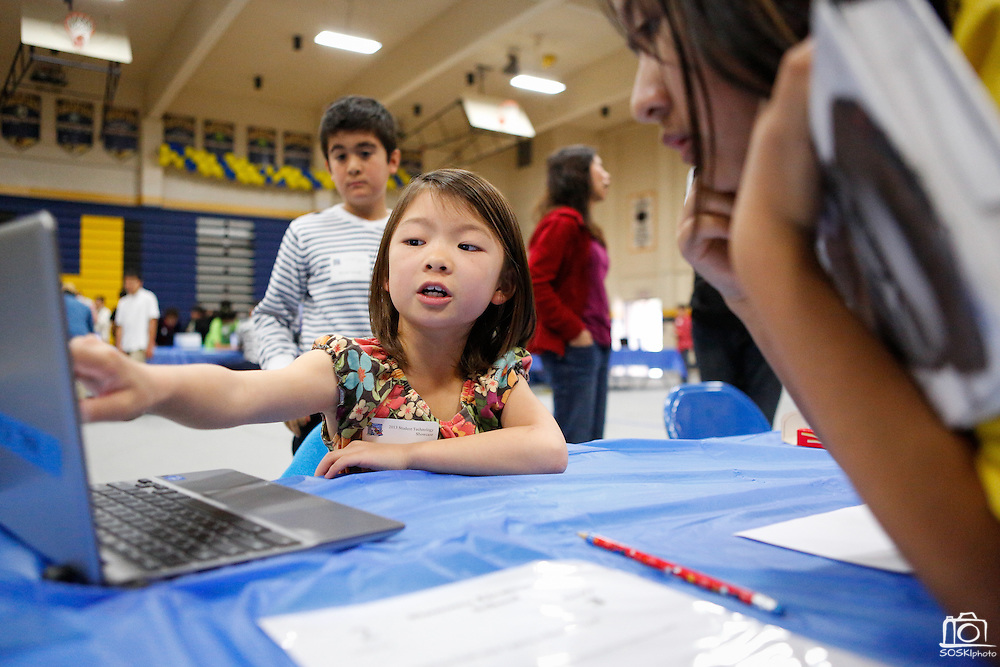 Leslie Kin, 8, of Sinnott Elementary School shows visitors how to type faster using the Typing Club program during the MUSD Student Technology Showcase at Milpitas High School in Milpitas, California, on March 2, 2013. (Stan Olszewski/SOSKIphoto)
