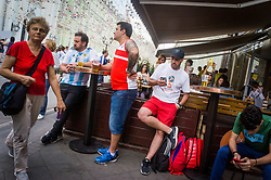 June 23, 2018 - Moscou, Moscow region, Russia - Russian football fans drink beer in the bar  (Credit Image: © Aleksei Sukhorukov via ZUMA Wire)