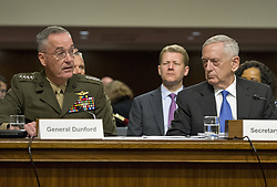 June 13, 2017 - Washington, District of Columbia, United States of America - United States Secretary of Defense James N. Mattis, right, and General Joseph F. Dunford, Jr., US Marine Corps, Chairman of the Joint Chiefs of Staff, left, give testimony before the US Senate Committee on Armed Services on ''the Department of Defense budget posture in review of the Defense Authorization Request for Fiscal Year 2018 and the Future Years Defense Program'' on Capitol Hill in Washington, DC on Tuesday, June 13, 2017..Credit: Ron Sachs / CNP (Credit Image: © Ron Sachs/CNP via ZUMA Wire)
