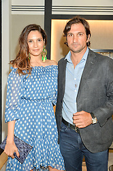 EDUARDO NOVILLO ASTRADA and his wife ASTRID MUNOZ at the Jaeger-LeCoultre Gold Cup draw 2016 held at Jaeger-LeCoultre, Bond Street, London on 6th June 2016.