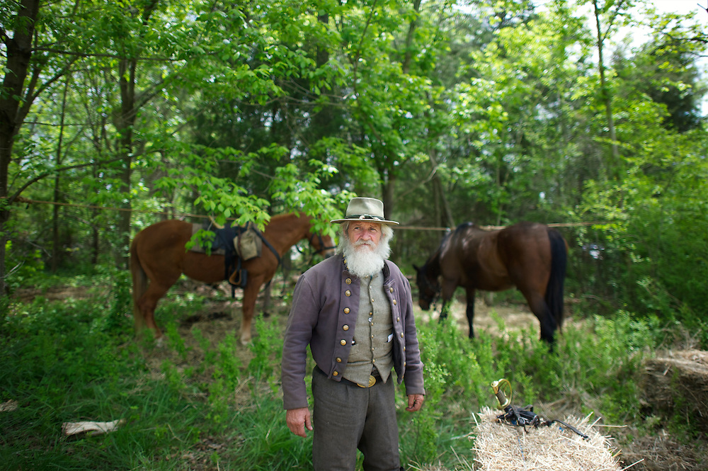 Harold Lawson, of the 2nd Virginia Corps, a member of General Jackson's Core Staff, gazes towards the gathering formations of troops before battle from his camp during the Chancellorsville 150th reenactment in Spotsylvania, VA on May 4, 2013.  He has been a reenactor for 30 years.