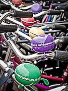 Bike bells on bikes for rent, Amsterdam.