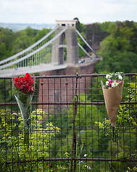 © Licensed to London News Pictures. 15/05/2015. Bristol, UK. Flowers left next to Avon Gorge in remembrance of Britain's oldest poppy seller, Olive Cooke, 92, who is believed to have taken her own life and jumped into Avon Gorge last week. Photo credit : Rob Arnold/LNP