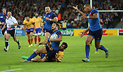 Bruce Dulin (France) is tackled by Catalin Fercu (Romania) during the Rugby World Cup Pool D match between France and Romania at the Queen Elizabeth II Olympic Park, London, United Kingdom on 23 September 2015. Photo by Matthew Redman.