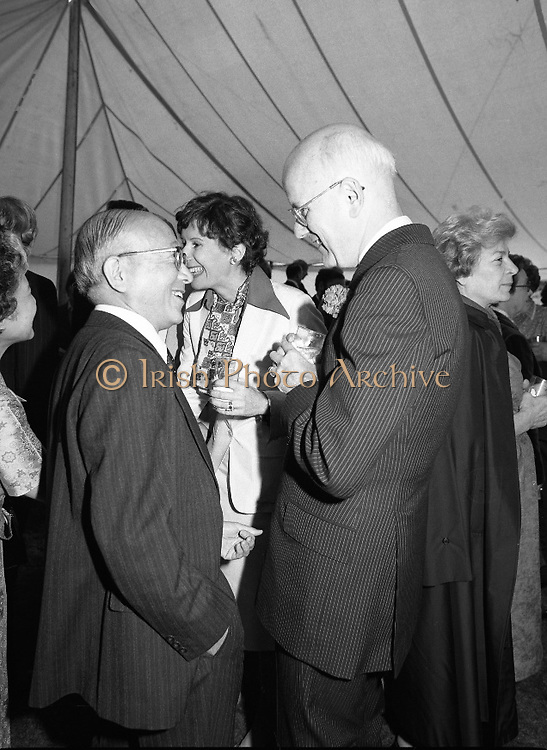 Guests and staff at the US Embassy in Phoenix Park, Dublin, celebrate American Independence Day..1980-07-04.4th July 1980.04/07/1980.07-04-80..Photographed at the US Ambassador's Residence,  Phoenix Park...US Ambassador William V Shannon and his wife Elizabeth McNelly Shannon chat with guests in marquee during festivities.