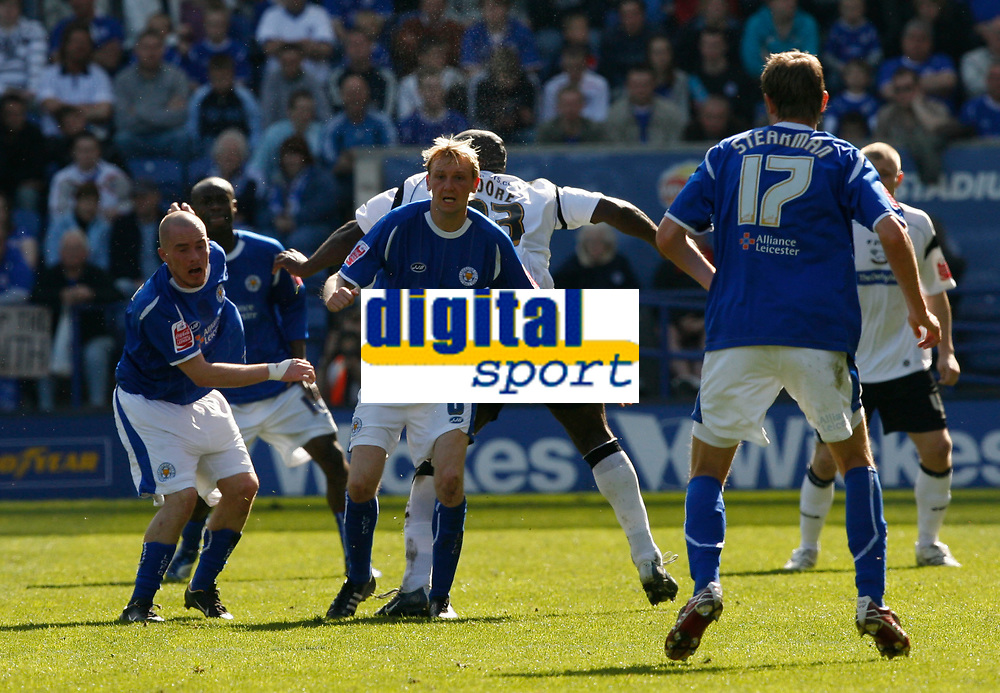 Photo: Steve Bond.<br />Leicester City v Derby County. Coca Cola Championship. 06/04/2007. Stephen Hughes (centre) holds the ball from Darren Moore (hidden)