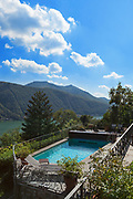 Nice terrace with swimming pool of house overlooking the lake