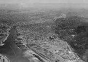 """Ackroyd 06281-4. """"August 22, 1950"""" Portland lower harbor. tip of Swan Island on lower left. Guilds lake on right looking south. Texaco tank farm on lower right."""