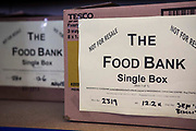 The Food Bank emergency food box which has been prepared and ready for distribution at the Wadebridge foodbank and storehouse in North Cornwall, UK.  This box contains non-perishable food for a single person.