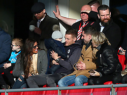"""Leicester City's Jamie Vardy (centre), formerly of Fleetwood Town, with his wife Rebekah and Daughter Sofia, in the stands during the FA Cup, third round match at Highbury Stadium, Fleetwood PRESS ASSOCIATION Photo. Picture date: Saturday January 6, 2018. See PA story SOCCER Fleetwood. Photo credit should read: Dave Thompson/PA Wire. RESTRICTIONS: EDITORIAL USE ONLY No use with unauthorised audio, video, data, fixture lists, club/league logos or """"live"""" services. Online in-match use limited to 75 images, no video emulation. No use in betting, games or single club/league/player publications."""