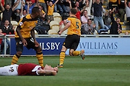 Chris Jones of Newport turns away to celebrate after scoring his side's second goal. Skybet football league two match, Newport county v Northampton Town at Rodney Parade in Newport, South Wales on Saturday13th Sept 2014<br /> pic by Mark Hawkins, Andrew Orchard sports photography.
