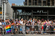 New York, NY - 25 June 2017. New York City Heritage of Pride March filled Fifth Avenue for hours with groups from the LGBT community and it's supporters. Spectators wait behind barriers at the Flatiron Building an Fifth Avenue.