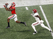 ATLANTA, GA - JANUARY 08:  Wide receiver Mecole Hardman #4 catches a pass for a touchdown behind safety Tony Brown #2 of the Alabama Crimson Tide during the College Football Playoff National Championship game at Mercedes-Benz Stadium on January 8, 2018 in Atlanta, Georgia.  (Photo by Mike Zarrilli/Getty Images)