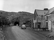 01/02/1957<br /> 02/01/1957<br /> 01 February 1957<br /> A view of the  tunnel road between Kenmare and Glengarriff. Renault 4CV car