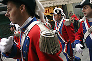 The Guards of the Miller, the most important character of the Carnival, and the girl who historically beheaded the tyrant Ranieri, are running through the narrow streets of Ivrea during the opening celebrations marking the historical Carnival of the town Ivrea, pop. 30.000. During the days of the Carnival, the town becomes crammed with tourists coming to witness the event which finds its roots at the end of the XII Century, when the people led an insurrection against the local tyrant, Count Ranieri of Biandrate, who was exercising the 'jus primae noctis' rule (having the first night) on the local young brides. The battle to overthrow him is represented with a 3-day-fight between factions in which more then 400 tonnes of oranges are thrown. During the celebrations, food stalls, bands playing music, and parades are also present, giving it a typical Medieval atmosphere.