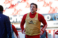 Aberdeen defender Ashton Taylor (14)] warming up during the Scottish Premiership match between Aberdeen and Motherwell at Pittodrie Stadium, Aberdeen, Scotland on 23 January 2021.