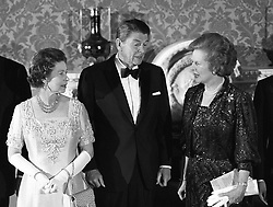 Left to right: Queen Elizabeth II, American President Ronald Reagan and British Prime Minister Margaret Thatcher at Buckingham Palace when they attended a special banquet hosted by the Queen following the London Economic Summit.
