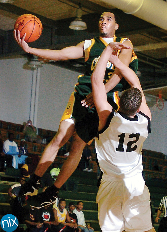 Coastal Georgia's Carvelle Taylor goes up for a shot against a Moody Air Force Base defender Thursday night. The Mariners won 138-58.