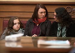 December 9, 2016 - Salem, Oregon, U.S - Plaintiff KELSEY JULIANA, in red scarf,  listens to the proceeding during a hearing before the  Oregon Court of Appeals in Salem. Juliana filed suit against Oregon Gov. Kate Brown and the state of Oregon for violating her constitutional and public trust rights. The case is seeking a court order to compel the state to take science-based action to address the climate crisis and prevent catastrophic and irreversible impacts. Juliana, and the girl seated next to her AVERY MCRAE, 11, are both plaintiffs in the landmark federal lawsuit against  the federal government over climate change. (Credit Image: © Robin Loznak via ZUMA Wire)