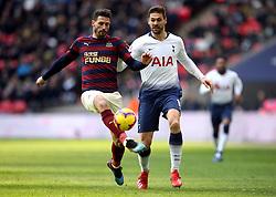 Newcastle United's Fabian Schar (left) and Tottenham Hotspur's Fernando Llorente battle for the ball during the Premier League match at Wembley Stadium, London.