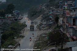 Riding into a mountain village where we regrouped before riding down a windy mountain road to our destination on day-7 of our Himalayan Heroes adventure riding from Tatopani to Pokhara, Nepal. Monday, November 12, 2018. Photography ©2018 Michael Lichter.