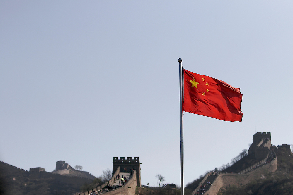 The People's Republic of China flag flies at the base of The Great Wall at Badaling.