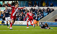 Middlesbrough's Patrick Bamford (right) wheels away to celebrate scoring his side's second goal, while Millwall players look on dejected<br /> <br /> Photographer Craig Mercer/CameraSport<br /> <br /> Football - The Football League Sky Bet Championship - Millwall v Middlesbrough - Saturday 6th December 2014 - The Den - London<br /> <br /> © CameraSport - 43 Linden Ave. Countesthorpe. Leicester. England. LE8 5PG - Tel: +44 (0) 116 277 4147 - admin@camerasport.com - www.camerasport.com