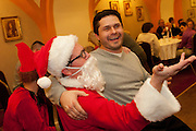 Attorney Robert P. Groszek of his namesake law firm sits atop Santa's lap (Cook County Assistant Public Defender Mark P. Douglass) during a Holiday Meeting of The Advocate Society/Association of Polish-American Attorneys at the Copernicus Foundation on Friday, December 21st. © 2012 Brian J. Morowczynski ViaPhotos