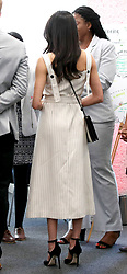 A back view of Meghan Markle during a reception with delegates from the Commonwealth Youth Forum at the Queen Elizabeth II Conference Centre, London, during the Commonwealth Heads of Government Meeting.