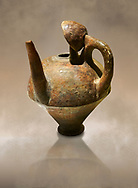 Terra cotta side spouted pitcher with lid - 1700 BC to 1500 BC - Kültepe Kanesh - Museum of Anatolian Civilisations, Ankara, Turkey,  Against a warm art  background .<br /> <br /> If you prefer to buy from our ALAMY STOCK LIBRARY page at https://www.alamy.com/portfolio/paul-williams-funkystock/hittite-art-antiquities.html  - Type Kultepe  into the LOWER SEARCH WITHIN GALLERY box. Refine search by adding background colour, place, museum etc<br /> <br /> Visit our HITTITE PHOTO COLLECTIONS for more photos to download or buy as wall art prints https://funkystock.photoshelter.com/gallery-collection/The-Hittites-Art-Artefacts-Antiquities-Historic-Sites-Pictures-Images-of/C0000NUBSMhSc3Oo