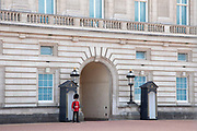 Outside Buckingham Palace a Grenadier Guard, while it is eerily quiet and silent on streets empty of tourists as lockdown continues and people observe the stay at home message in the capital on 11th May 2020 in London, England, United Kingdom. Coronavirus or Covid-19 is a new respiratory illness that has not previously been seen in humans. While much or Europe has been placed into lockdown, the UK government has now announced a slight relaxation of the stringent rules as part of their long term strategy, and in particular social distancing.