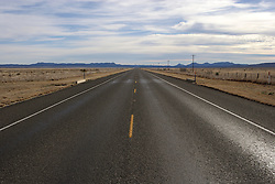 Wide open road and landscape, Terrell County, Texas.