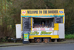 Lamberton, Scotland, UK. 21 December 2020.  Border between Scotland and England on the A1 north of Berwick upon Tweed very quiet  with few motorists, however frequent police patrols are evident. Snack van is not busy.  Iain Masterton/Alamy Live News