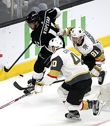 April 17, 2018 - Los Angeles, California, U.S - Los Angeles Kings' forward Anze Kopitar (11) vies with Vegas Golden Knights' forward Ryan Carpenter (40) and Vegas Golden Knights' forward Jonathan Marchessault (81) during the Game 4 of an NHL hockey first-round playoff series in Los Angeles, April 17, 2018. The Golden Knights won 1-0. (Credit Image: © Ringo Chiu via ZUMA Wire)