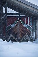 Snow storm and old wooden boat, Reine, Moskenesøy, Lofoten Islands, Norway