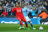 Roberto Firmino of Liverpool holds off Fernando of Manchester City . Capital One Cup Final, Liverpool v Manchester City at Wembley stadium in London, England on Sunday 28th Feb 2016. pic by Chris Stading, Andrew Orchard sports photography.