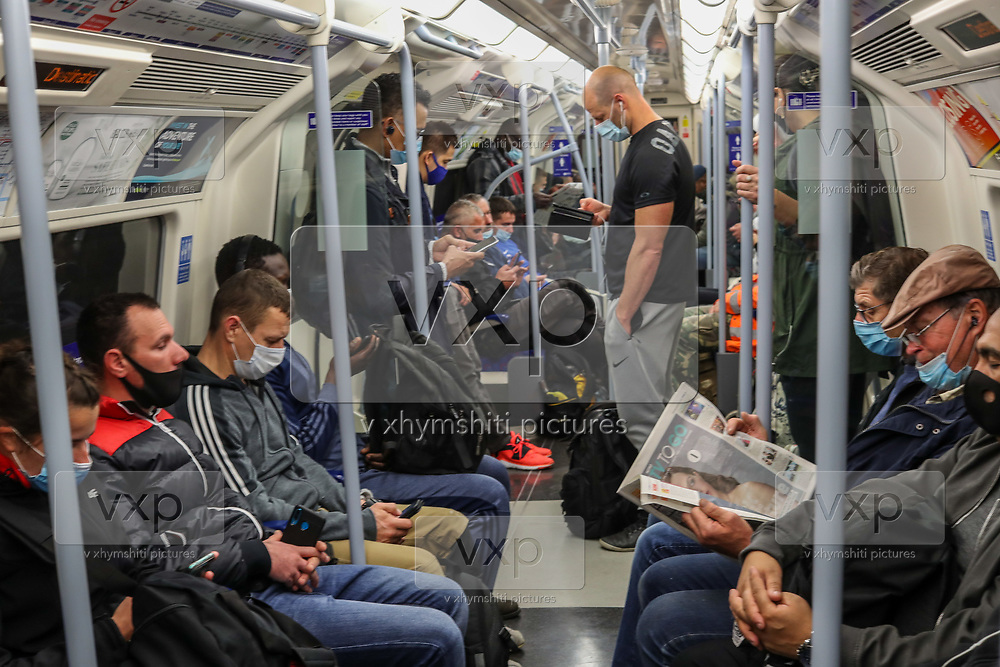 Londoners wearing face protective masks commute on a TFL Westbound Jubilee Line via London Bridge on Wednesday, Sept 30, 2020. Health Secretary Matt Hancock has come under pressure to give MPs a say over coronavirus lockdown restrictions before they come into force. On Wednesday MPs will be asked to renew emergency powers, originally passed in March, to tackle the pandemic. (VXP Photo/ Vudi Xhymshiti)