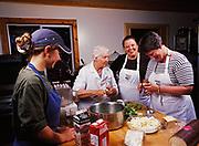 Sara Spudowski, Kirsten Dixon and Patty Park enjoying cooking seminar led by Madeleine Kamman, Winterlake Lodge, Alaska.