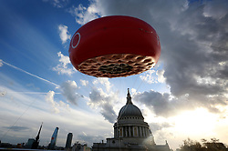 EDITORIAL USE ONLY<br /> A 5 metre inflatable version of the new FOREO UFO, the world&Otilde;s first smart mask device appears at St Paul&Otilde;s in London to celebrate National Alien Day today.