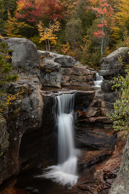 Screw Auger falls seen with peak autumn foliage on a chilly fall afternoon.