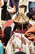 Africa, northern Ethiopia, Lalibela, The Market. People travel for days to come and trade goods at the market woman carrying a basket of Injera bread made of teff on her head
