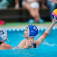 Dora Antal (L) of Hungary tries to block a hit by Ma Huanhuan (R) of China during the women waterpolo friendly match of Hungary and China in Tatabanya, Hungary on June 23, 2012. ATTILA VOLGYI