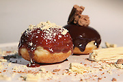 Sufganiyah (Sufganyot) a traditional Jewish Doughnut eaten during Hanukkah with chocolate Flake